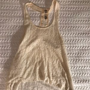 Free people tank with beads on back strap.